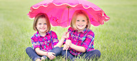 Rosacker girls under umbrella